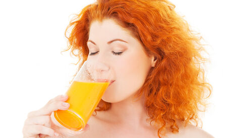 bright picture of lovely woman with glass of juice Stock Photo - 5668968