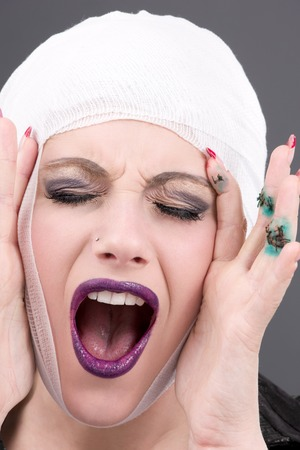 picture of screaming wounded woman face over grey Stock Photo - 5685123