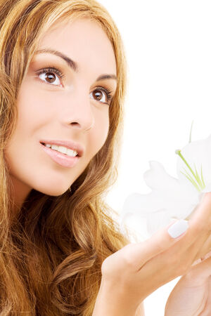 happy woman with white madonna lily flower Stock Photo - 5685316