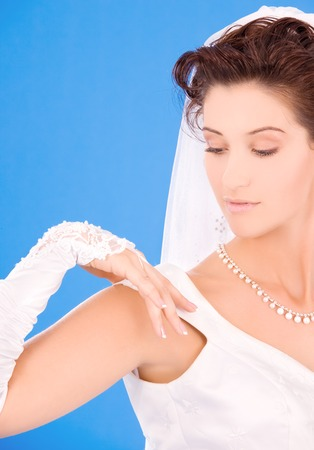 happy bride with her wedding ring over blue Stock Photo - 5685355