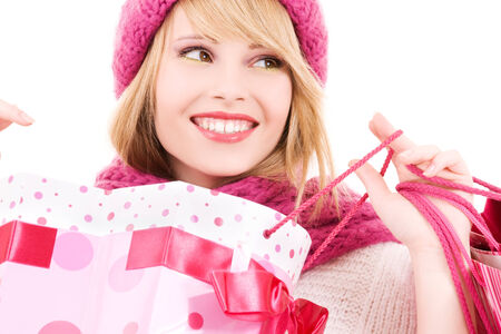 happy teenage girl in hat with pink shopping bags Stock Photo - 5685022