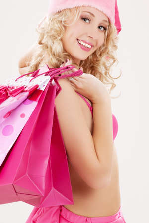 cheerful santa helper with pink shopping bags Stock Photo - 5685264