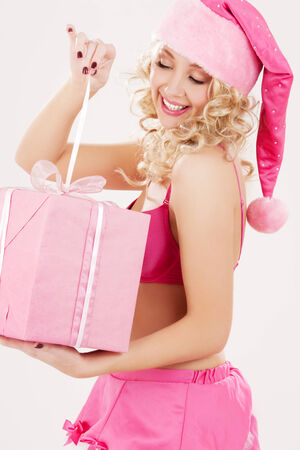 picture of cheerful santa helper girl with gift box Stock Photo - 5685206
