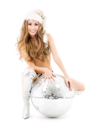 santas  helper: sexy santa helper with big disco ball over white