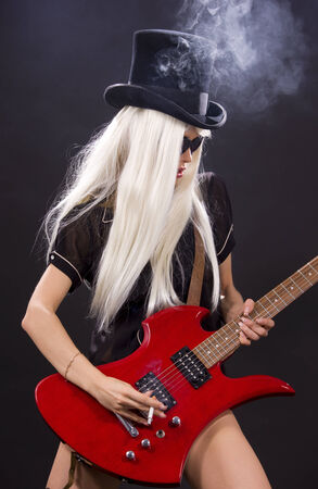 woman in top hat with red electric guitar and cigarette Stock Photo - 5685175