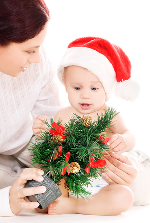 baby and mother with christmas gifts over white Stock Photo - 5677036