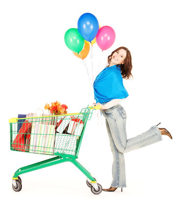 happy woman with shopping cart and balloons over white Stock Photo - 5668876