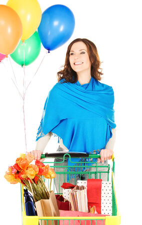 woman shopping cart: happy woman with shopping cart and balloons over white