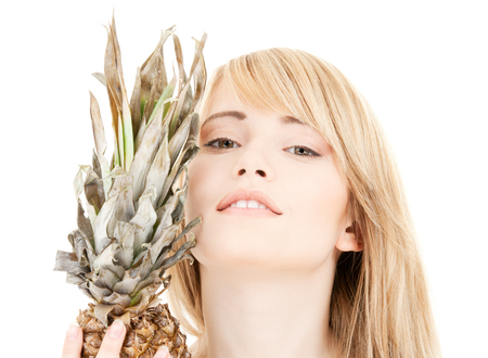 bright picture of lovely blonde with pineapple Stock Photo - 5676934