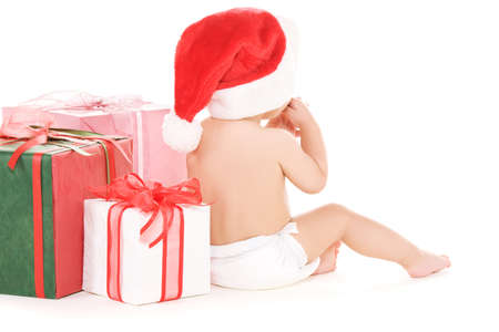 santas  helper: santa helper baby with christmas gifts over white LANG_EVOIMAGES
