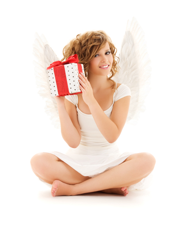 barefoot teens: picture of happy teenage angel girl with gift over white LANG_EVOIMAGES