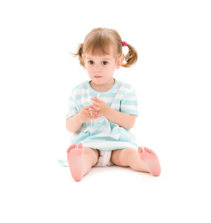 picture of little girl with cotton sticks over white Stock Photo - 5668686