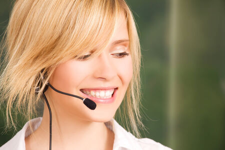 bright picture of friendly female helpline operator Stock Photo - 5685280