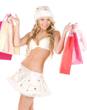 santa lingerie: cheerful santa helper with shopping bags over white