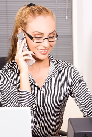 picture of lovely girl with cell phone in office Stock Photo - 5685245