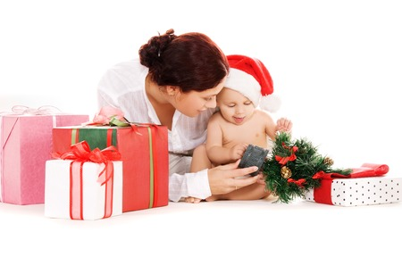 baby and mother with christmas gifts  over white Stock Photo - 5668972
