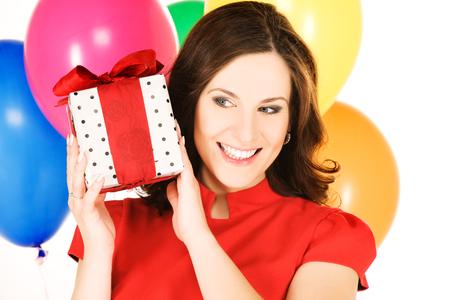 anniversary sexy: happy woman with gift box and balloons
