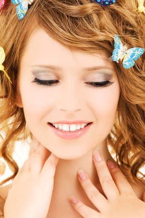 picture of teenage girl with butterflies over white Stock Photo - 5692840