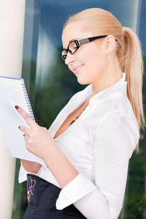 bright picture of lovely businesswoman in office photo