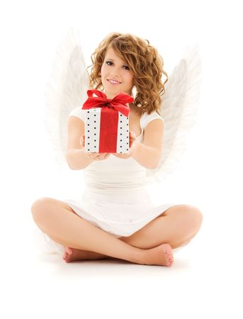 picture of happy teenage angel girl with gift over white photo