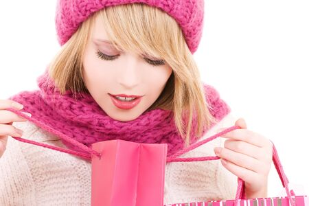 happy teenage girl in hat with pink shopping bags Stock Photo - 5672459