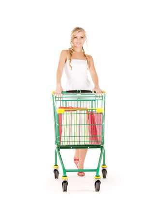 woman shopping cart: happy woman with shopping cart over white