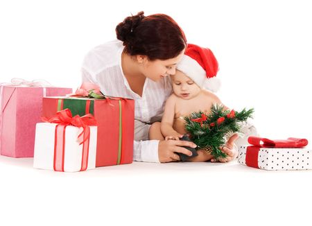 baby and mother with christmas gifts  over white photo