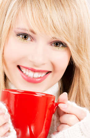 picture of happy teenage girl with red mug photo