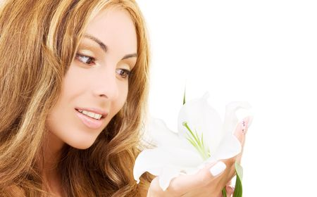 happy woman with white madonna lily flower photo