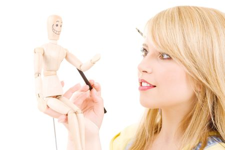 happy teenage girl with wooden model dummy over white Stock Photo - 5717992