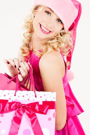 picture of cheerful santa helper girl with shopping bags Stock Photo - 5717885