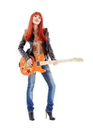 picture of lovely redhead girl with orange guitar Stock Photo - 5717924
