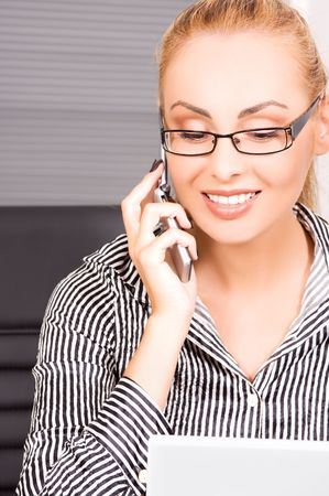 picture of lovely girl with cell phone in office Stock Photo - 5717917