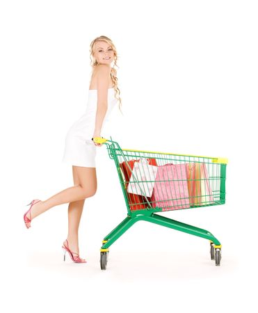 supermarket cart: happy woman with shopping cart over white