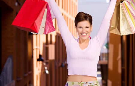 outdoor picture of happy woman with shopping bags Stock Photo - 5718052