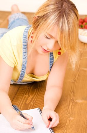 picture of teenage girl with notebook and pen photo