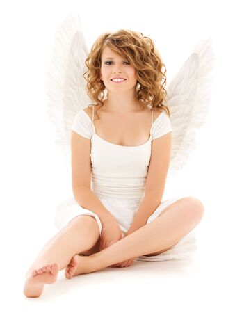 picture of happy teenage angel girl over white Stock Photo - 5718311