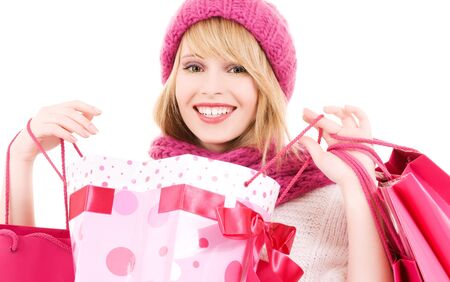 happy teenage girl in hat with pink shopping bags Stock Photo - 5718056