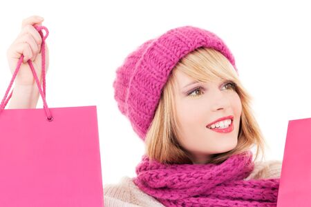 happy teenage girl in hat with pink shopping bags Stock Photo - 5741508