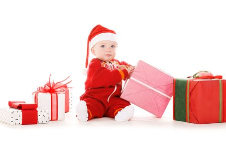 santa helper baby with christmas gifts over white Stock Photo - 5744739