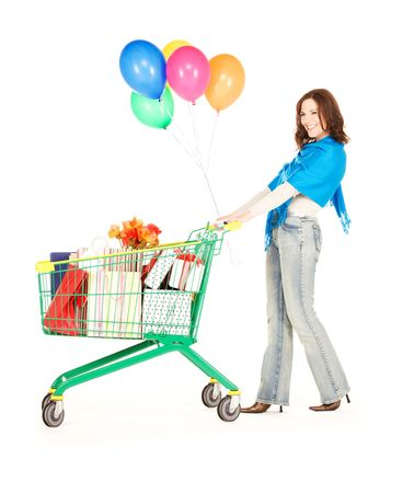 happy woman with shopping cart and balloons over white photo