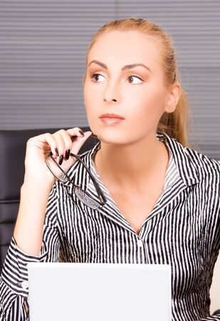 picture of lovely girl with computer in office Stock Photo - 5744741