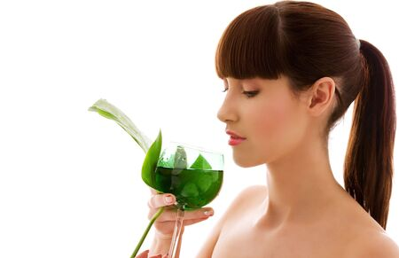 picture of woman with green leaf and glass of water photo