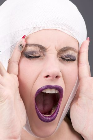 picture of screaming wounded woman face over grey photo