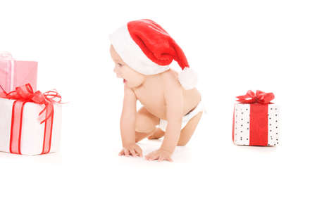 santa helper baby with christmas gifts over white photo