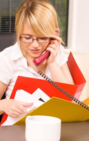 picture of lovely girl with phone in office Stock Photo - 5753047