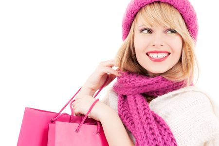 happy teenage girl in hat with pink shopping bags Stock Photo - 5753053