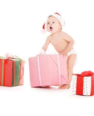 tot: santa helper baby with christmas gifts over white Stock Photo