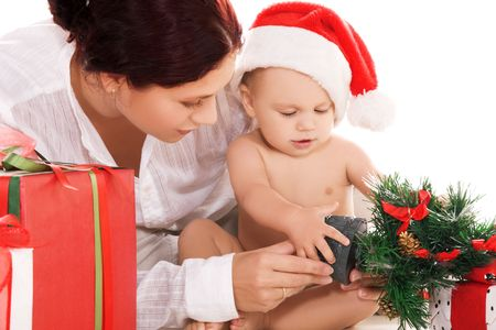 baby and mother with christmas gifts over white (focus on boy) photo