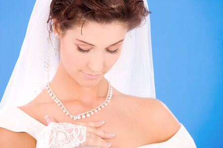 happy bride with her wedding ring over blue Stock Photo - 5771984